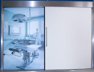 Automatiktür, OP-Tür, OP-Türen, Automatiktüren, automatische Drehtür, Schiebetür, Karusselltür, Karusselltüren, Türen, Tür, Drehtüren, Schiebetüren, Vollöffnung, Teilöffnung, Krankenhaus, Operationssaal, Strahlenschutzausführung, Durchblickfenster, Laserschutzjalousien, Sicherheitssensor, Lichtschranke