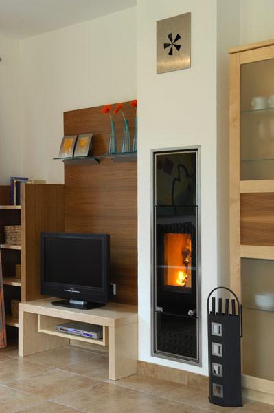 heizung f r holzpellets im schornstein plewa unitherm. Black Bedroom Furniture Sets. Home Design Ideas