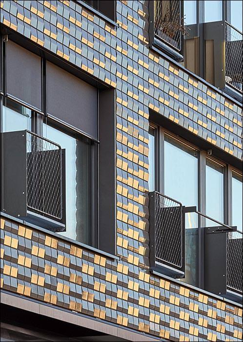 Sozialverträgliches Wohnungsbauprojekt mit kleinen Keramik-Fassadenelementen ganz groß auf WDVS